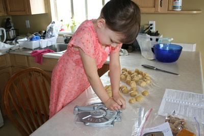 Abbie-flattens-tortillas-with-press